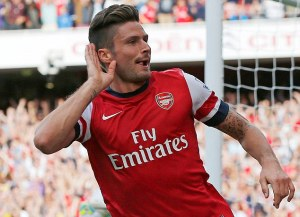 Arsenal's Giroud celebrates scoring against Tottenham Hotspur during their English Premier League soccer match at the Emirates, London