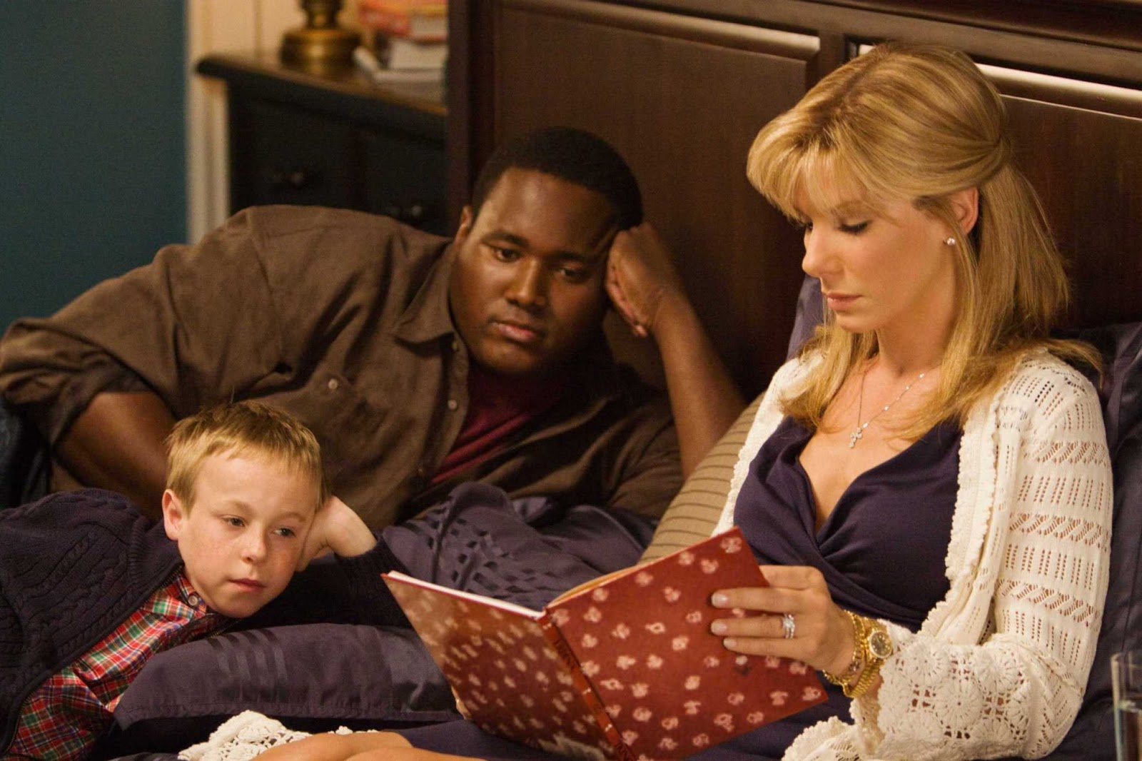 on the blind side and white paternalism the progressive democrat sandra bullock reads a story to her child son and michael oher